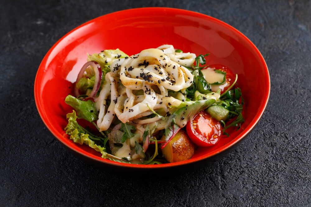 Salad with squid and grill