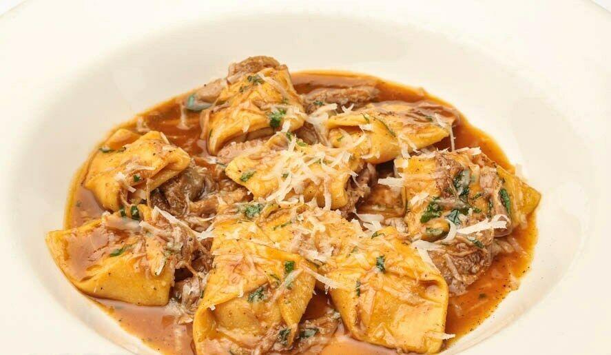 Tortellini with duck stew and pumpkin