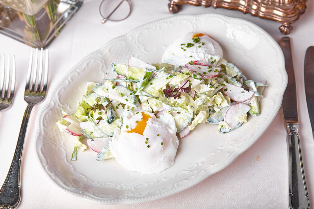 Spring salad with poached egg