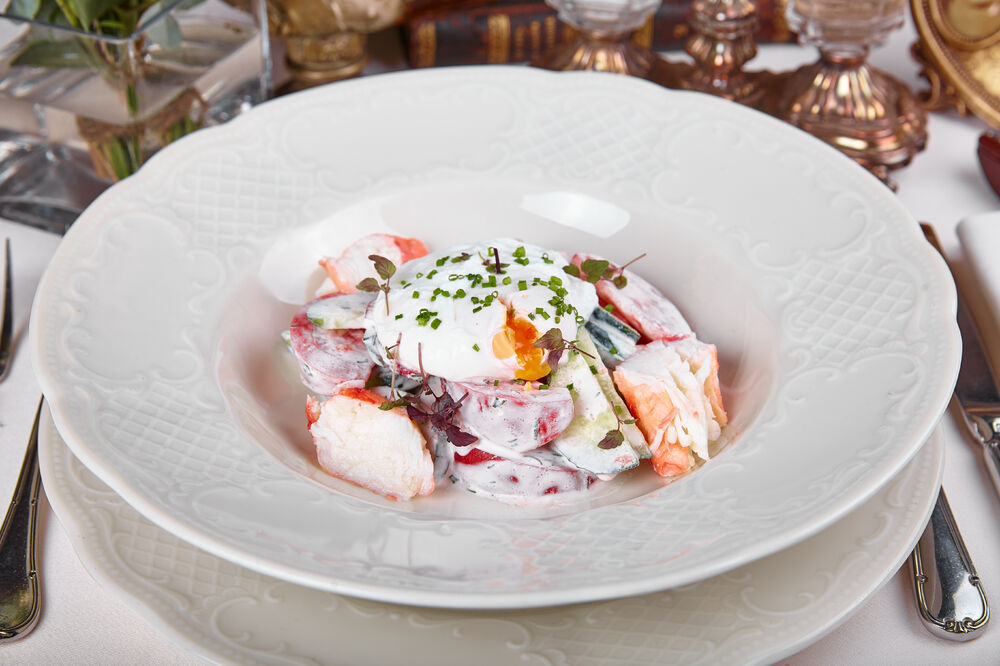 Salad with crab and poached egg