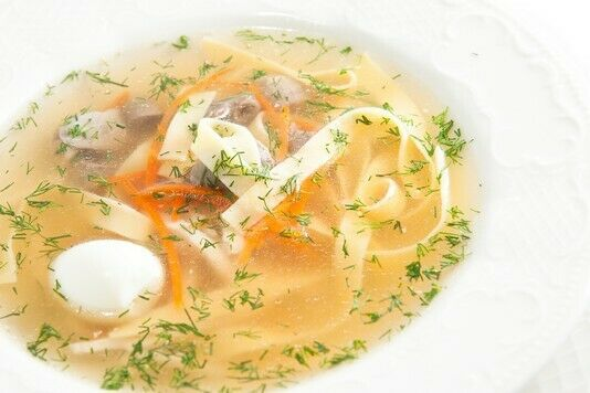 Chicken broth with noodles and giblets