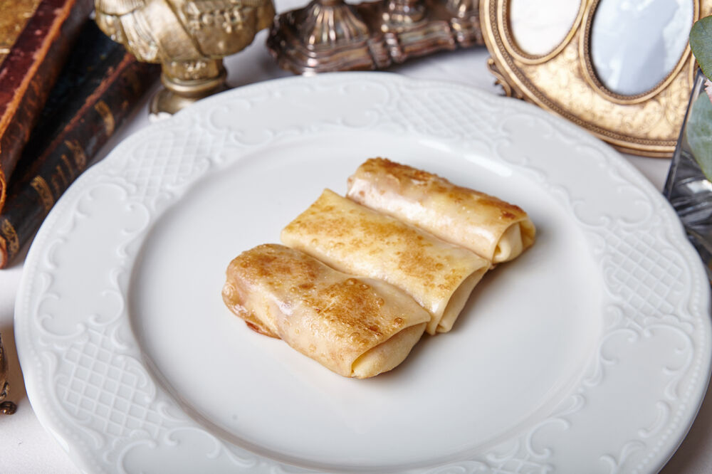 Crepes with cottage cheese and strawberry jam