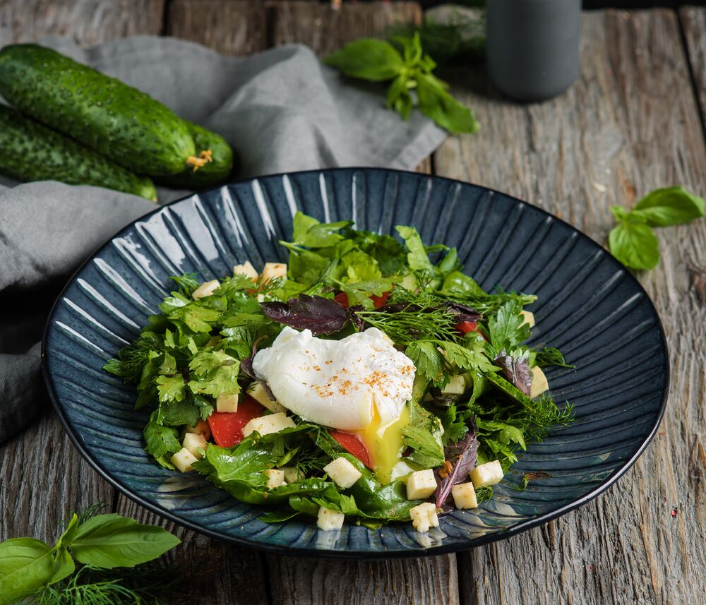 Salad with Baku vegetables and poached egg