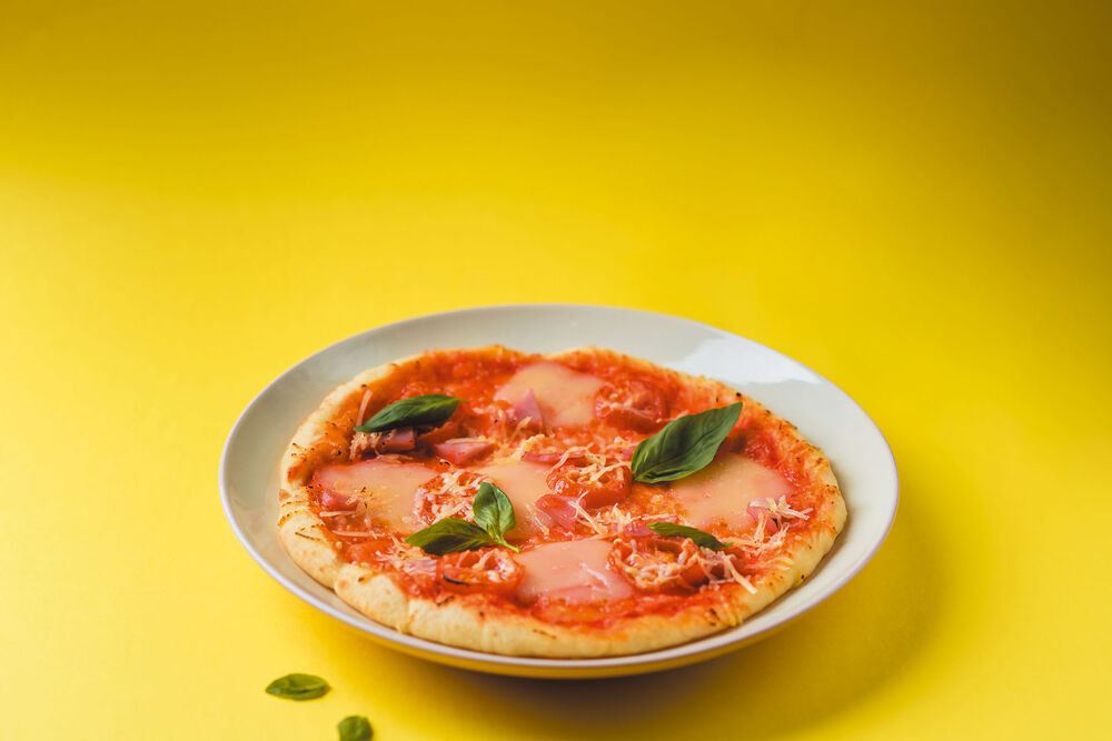 Pizza with parm and tomats