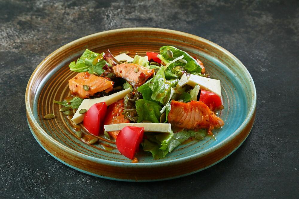 Warm salad with salmon and suluguni cheese