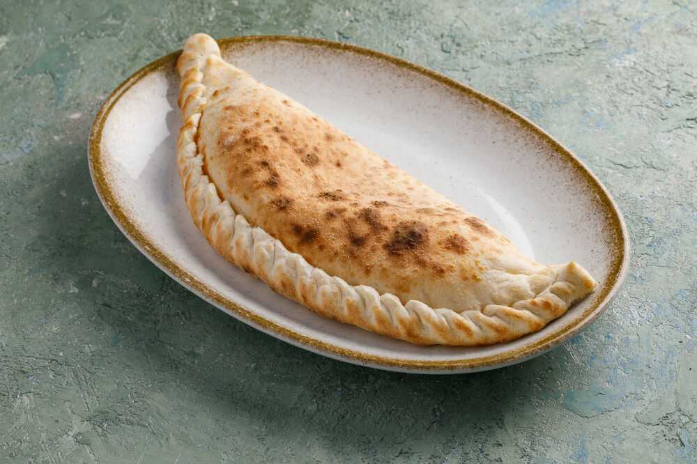 Calzone with bacon and salami