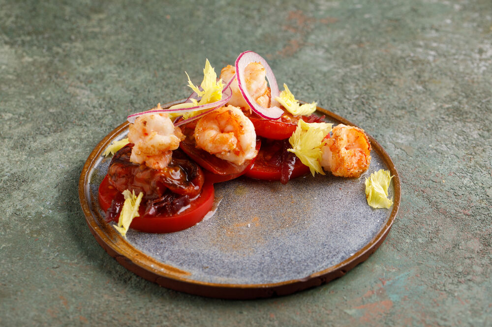 Two types of tomatoes with shrimps and sweet onions