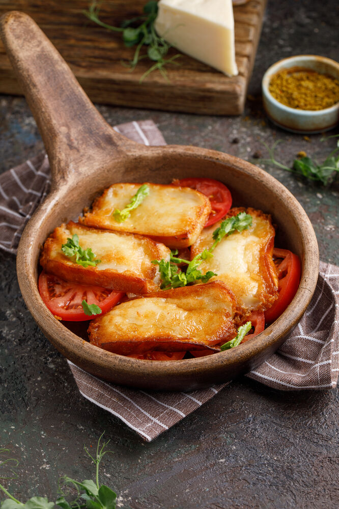 Fried Suluguni cheese with fresh tomatoes
