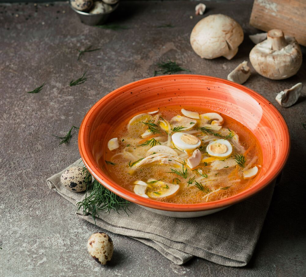Homemade noodle soup with mushrooms