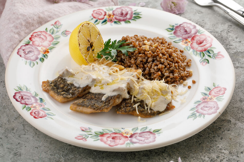 Carp fillet baked with sour cream served with buckwheat