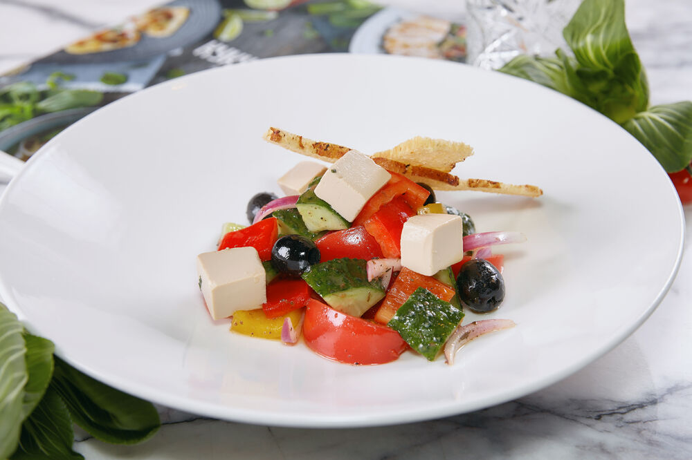 Greek salad with pickled Tofu and croutons