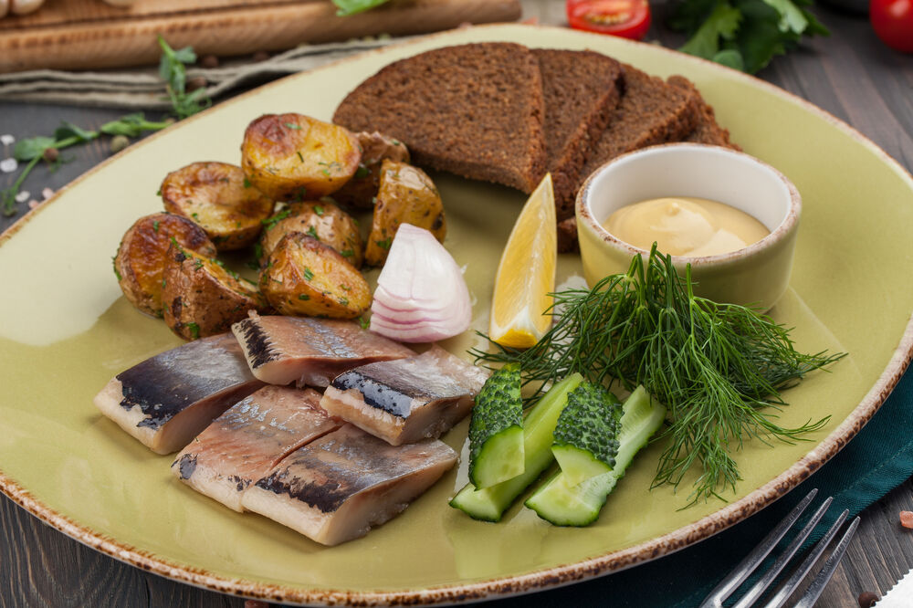 Pacific herring with baked potatoes and borodinsky bread