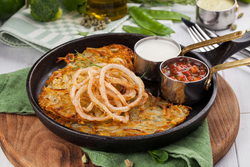 Potato pancakes with crispy onions and tomato salsa