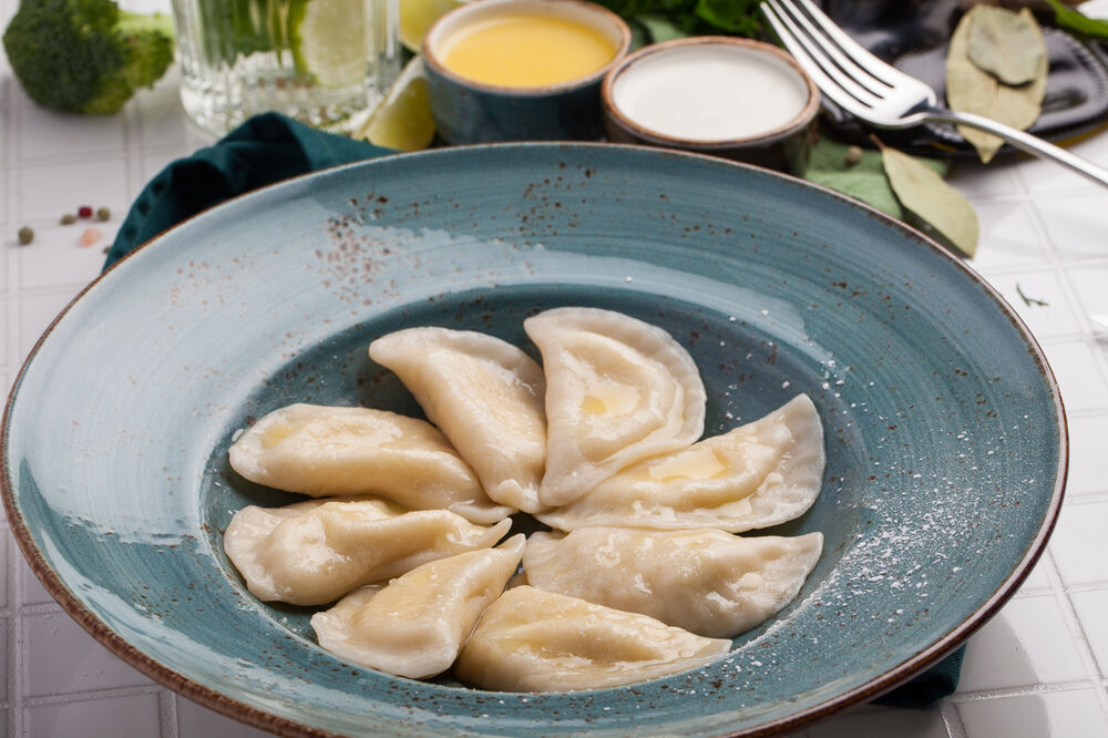 Dumpling with cottage and sour creame