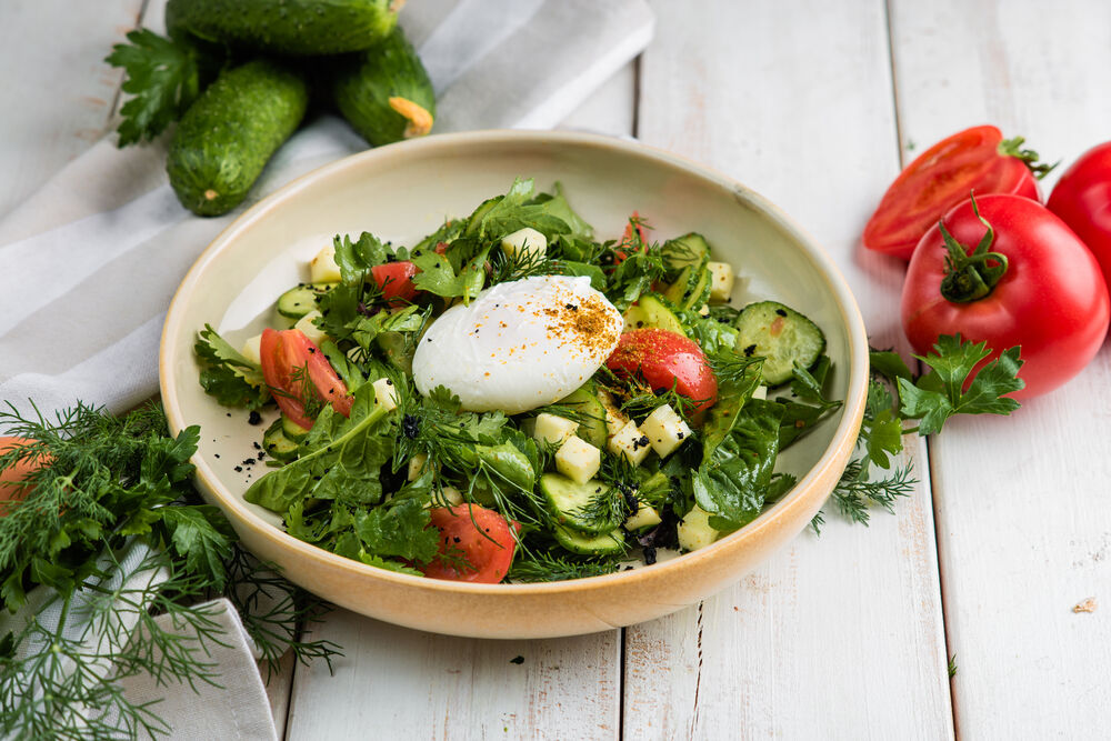 Salad with Baku vegetables, greens and poached egg
