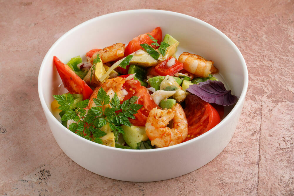 Vegetable salad with crab meat and grilled shrimps