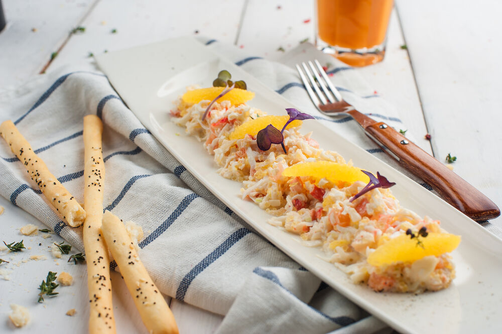 Crab salad with pike caviar and oranges
