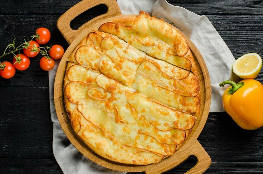 Khachapuri with smoked Suluguni cheese