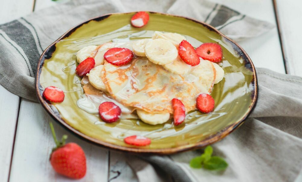 Pancakes with banana and condensed milk