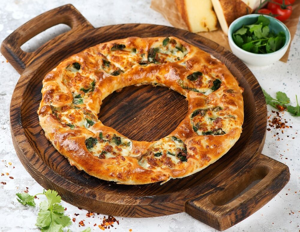 Khachapuri with cheese and greens