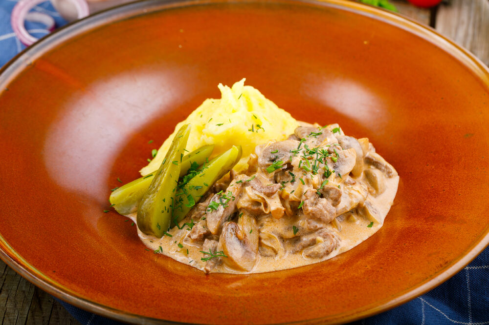 Beef Stroganoff with field mushrooms and mashed potatoes