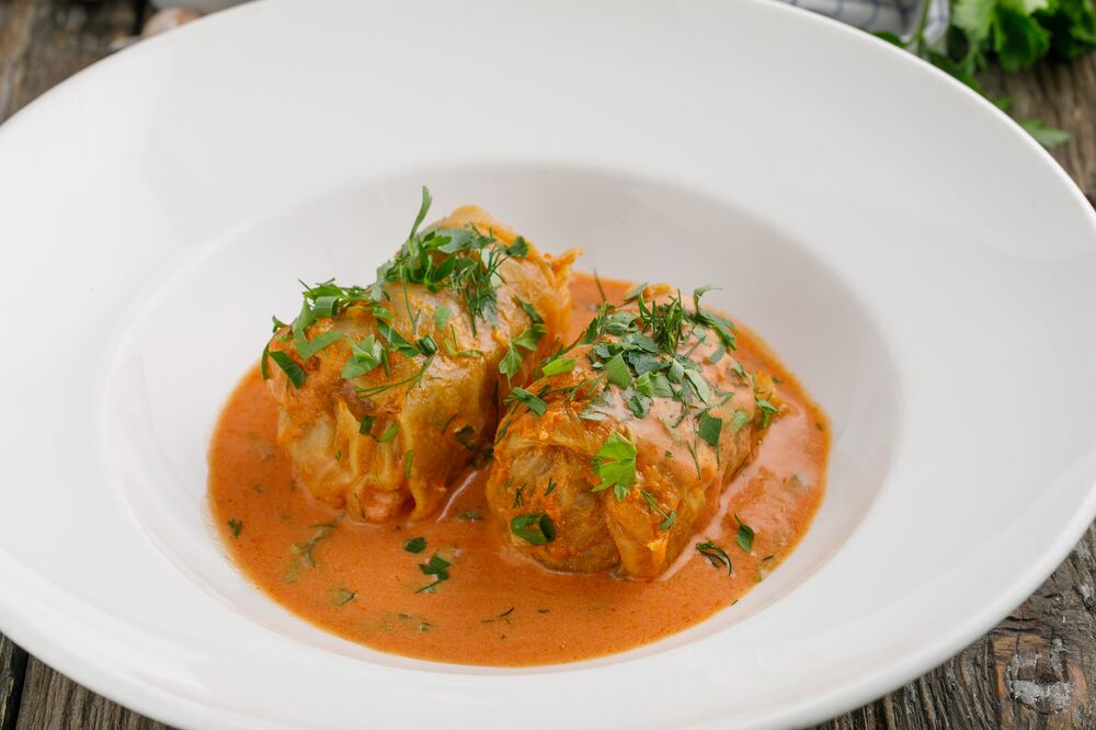 Homemade cabbage rolls with sour cream