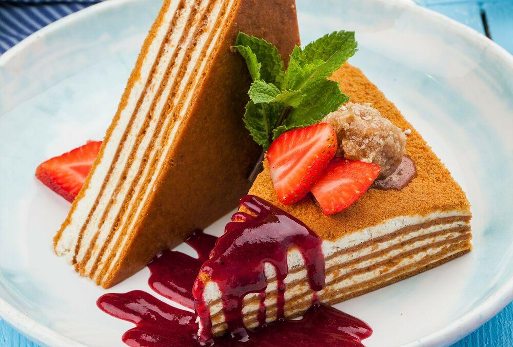 Honey cake with cranberry sauce