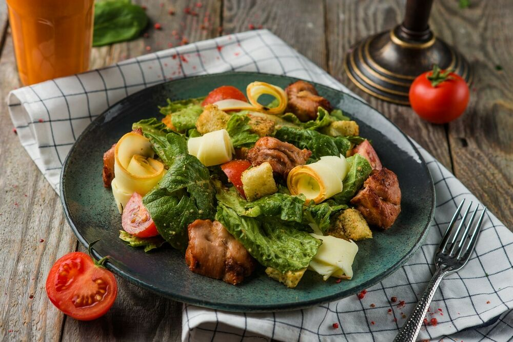 Warm salad with chicken and smoked suluguni cheese