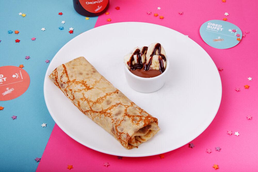 Big pancake with banana and chocolate