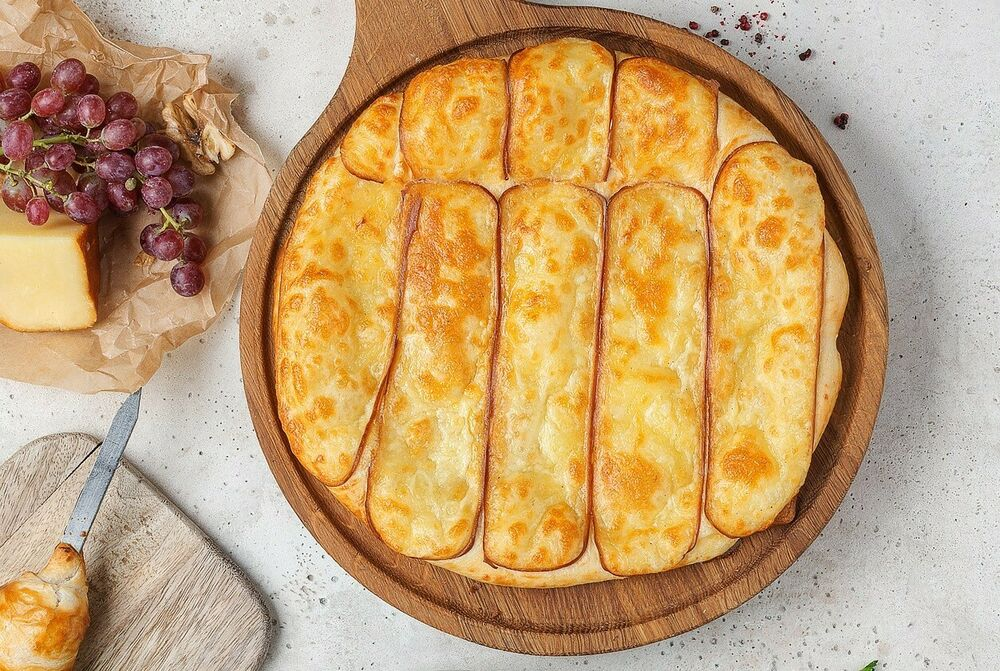 Khachapuri with smoked Suluguni cheese