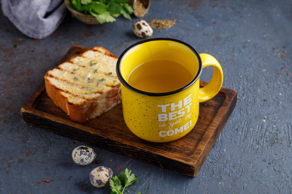 Chicken broth with toasted bread
