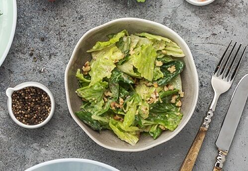 Salad with romaine and walnut sesame dressing