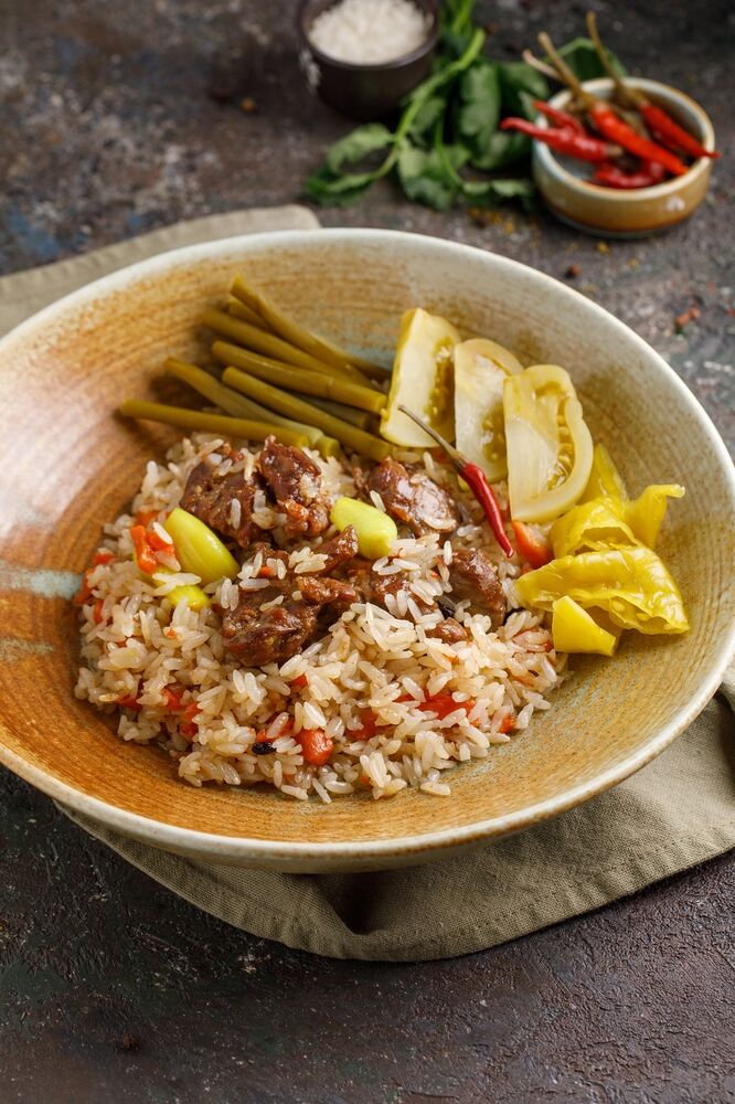 Uzbek pilaf with lamb and pickles