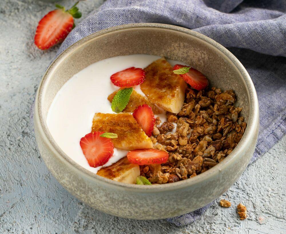 Granola with homemade yogurt and fried banana