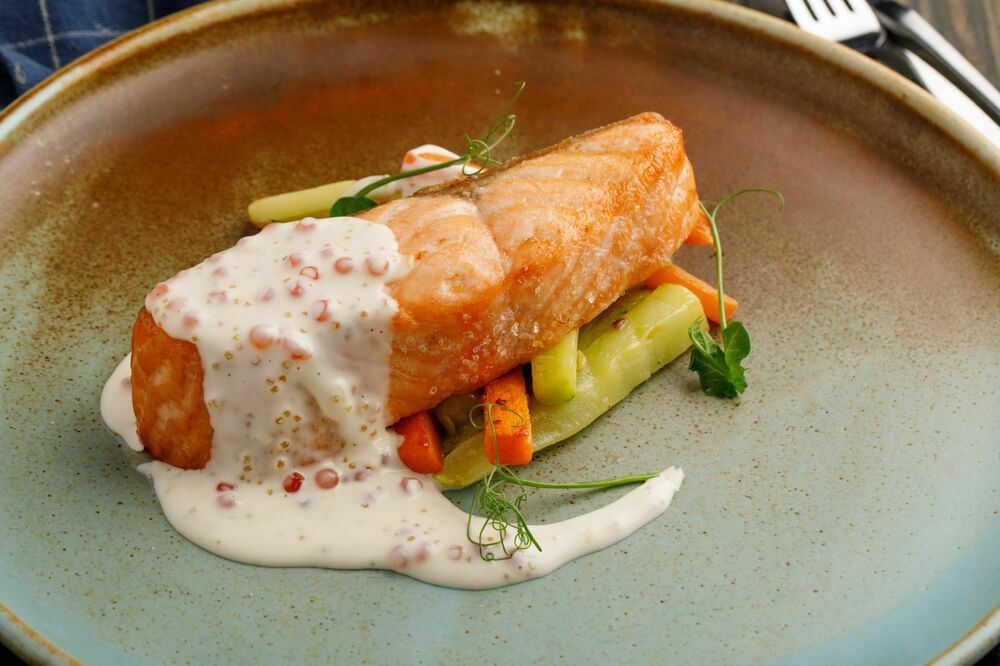 Salmon steak with vegetables and caviar sauce