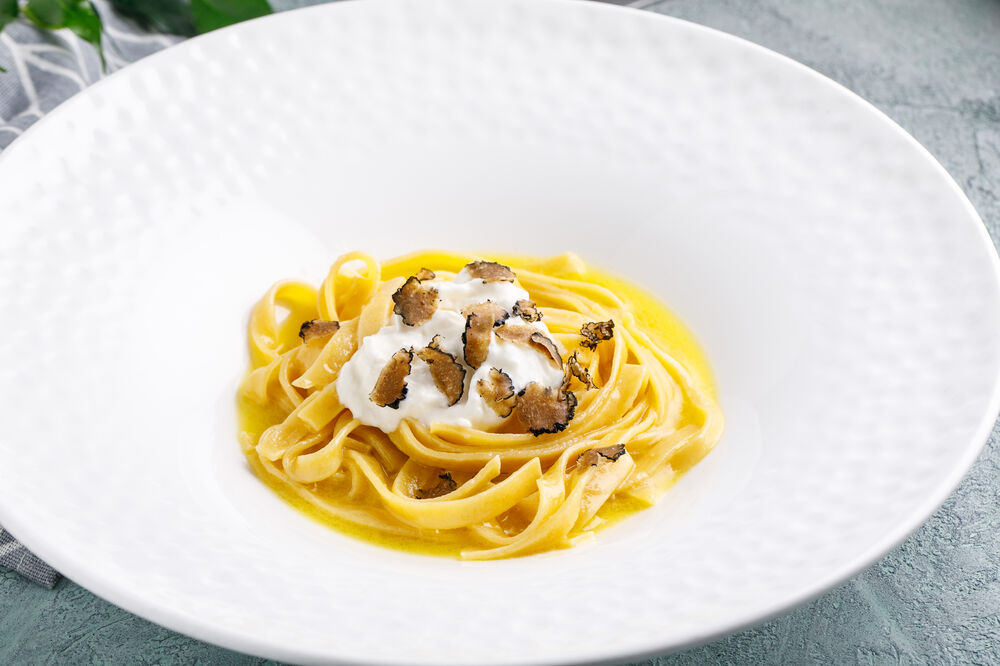 Pasta with burrata and black truffle
