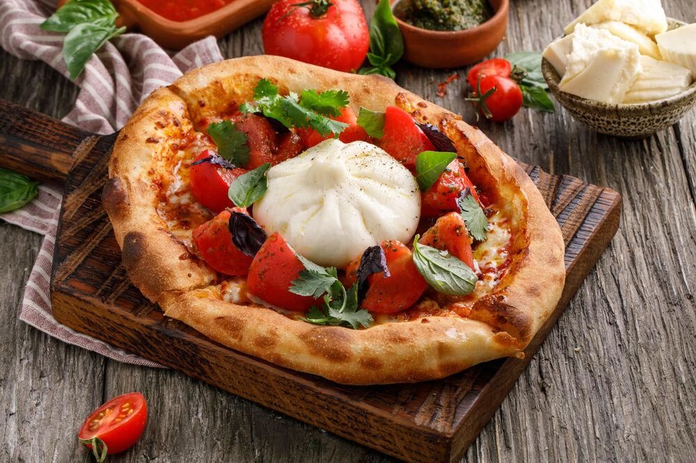 Homemade tortilla with tomatoes and homemade cheese khinkali