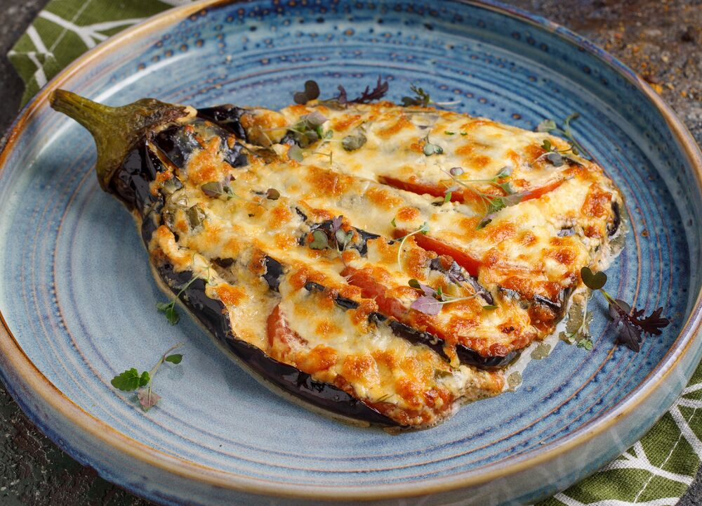 Fan of eggplant with tomatoes and Suluguni cheese