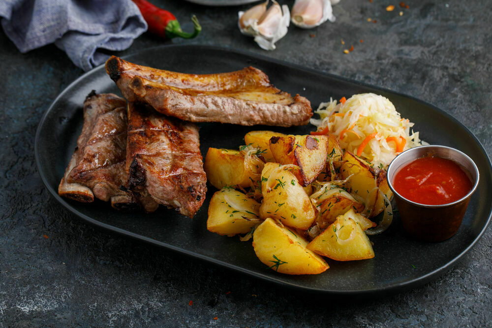 Charcoal ribs with golden potatoes