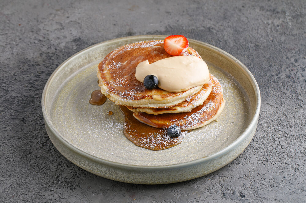 Breakfast Pancakes with maple syrup and berries
