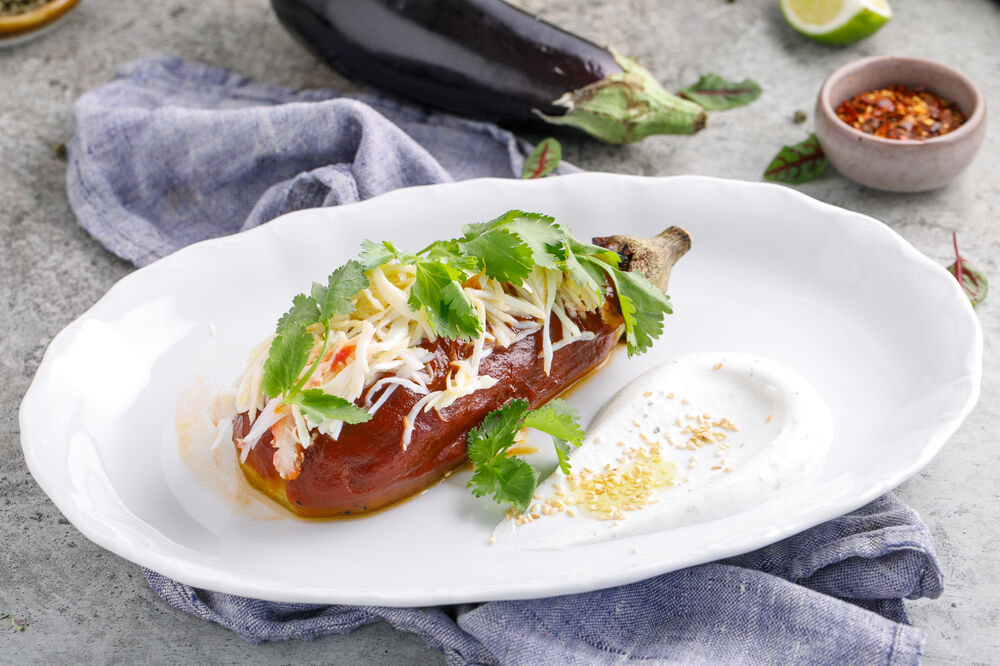Baked aubergine in pepper sauce with crab meat
