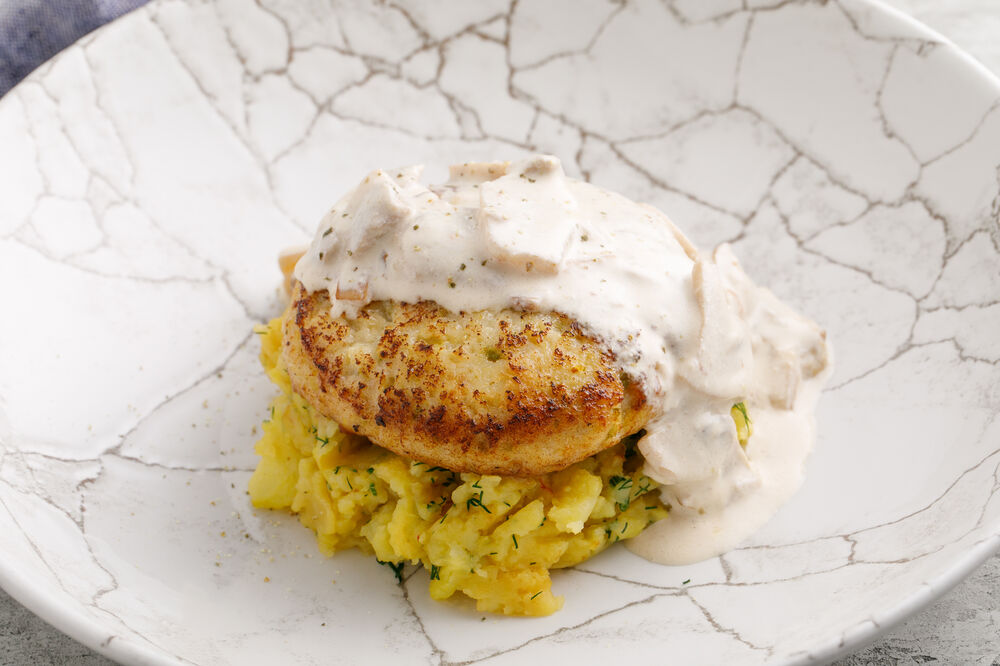 Fish patty with baked potatoes and mushroom fricassee