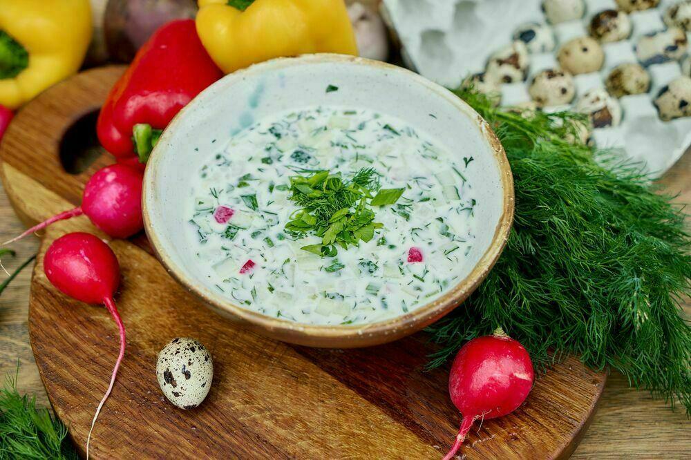 Homemade okroshka with veal roast beef on yogurt