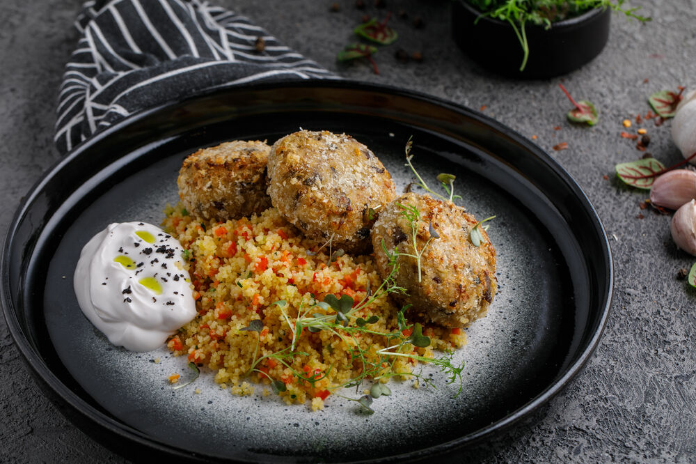 Cabbage cutlets with mushrooms and couscous