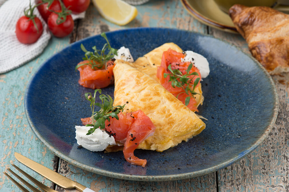 Omelette with tender smoked salmon and Сream cheese sauce
