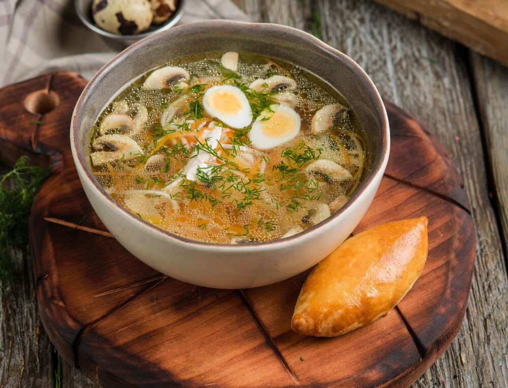 Homemade soup with chicken breast and mushrooms