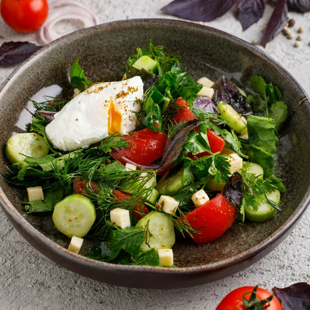 Salad with Caucasian greens and poached egg