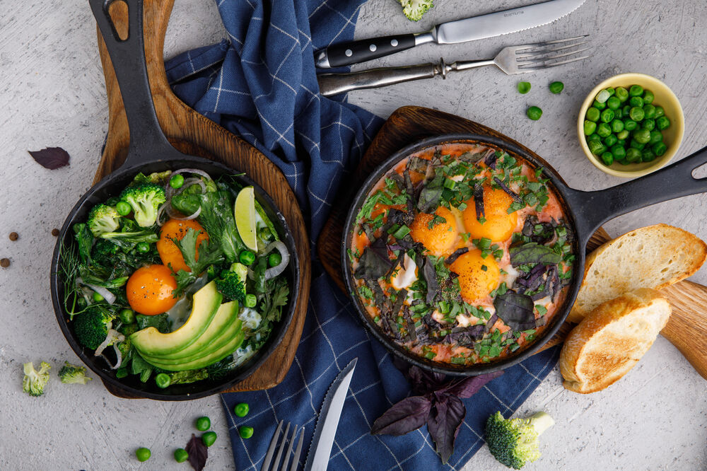 Shakshuka with greens, spinach and avocado