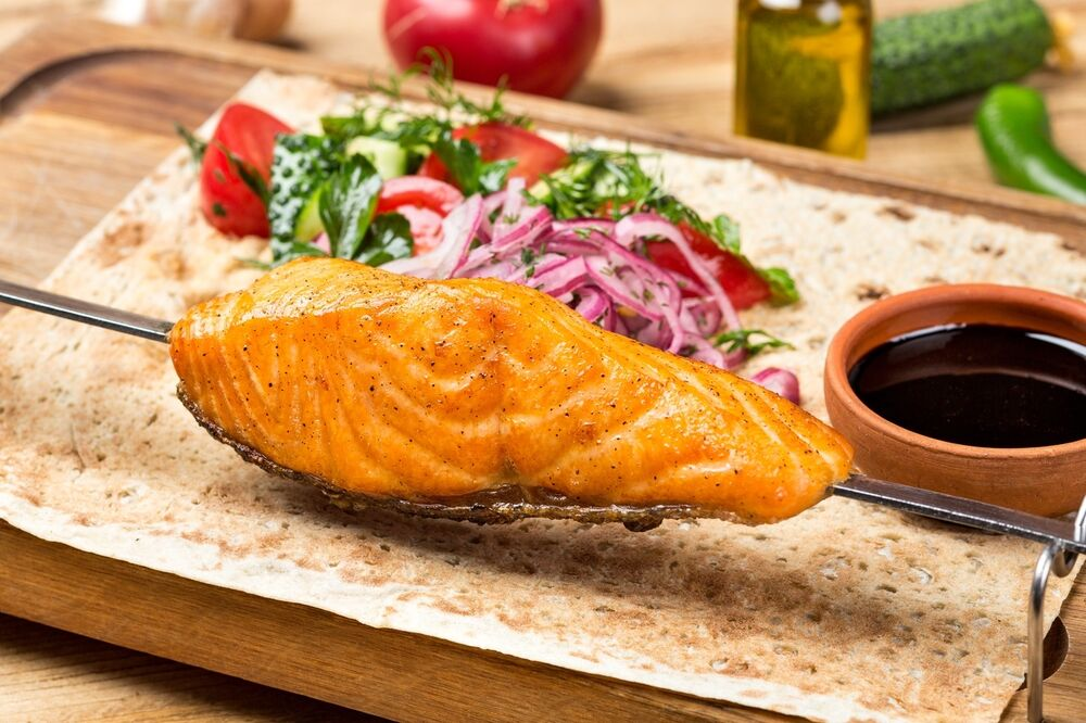 Salmon cooked on charcoal grill