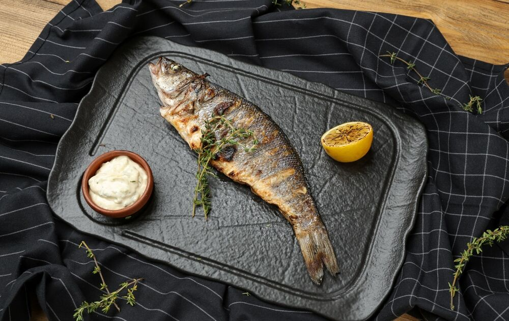 Sea bass cooked on charcoal grill